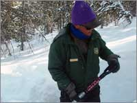 Worker prepares snowpack-sampling pit at Elkhart Park, Wyo.