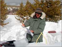 Worker prepares snowpack-sampling pit at Old Faithful Fire Road, Wyo.