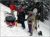 Workers prepare to haul snow samples away from site at Teton Pass, Wyo.