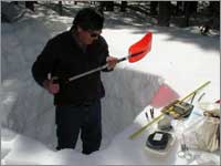 Worker makes measurements in snowpit near University Camp, Colo.